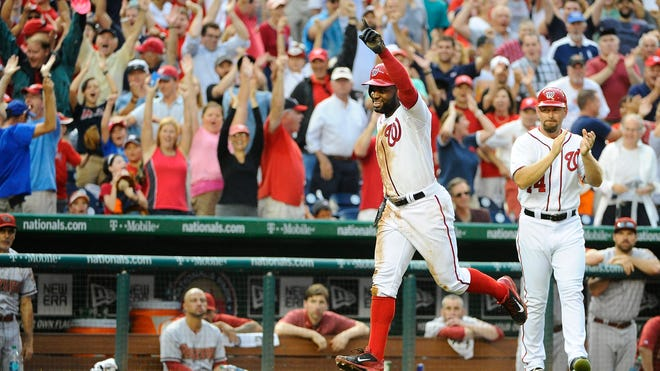 Washington Nationals center fielder Denard Span scores the winning run against the Arizona Diamondbacks during the ninth inning at Nationals Park. The Nationals won 1-0 and now have 10 straight wins.