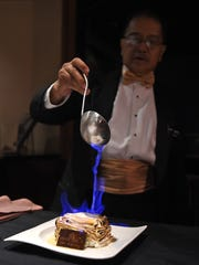 Bong Genio flames baked Alaska, a classic American dessert. Genio is something of a classic himself: He's worked at Harrah's Steak House for more than 40 years.