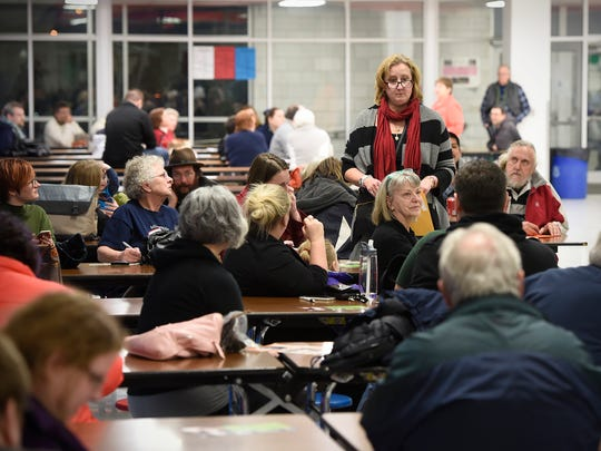 Voters gather at North Junior High Schoo during the DFL caucuses Tuesday in St. Cloud.