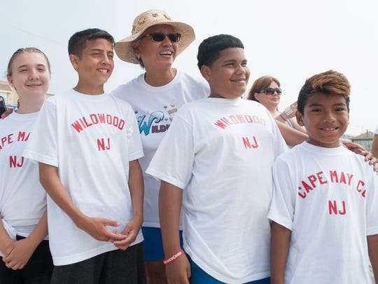 Betty Harshaw, coach of the Wildwood and Cape May County marble teams, stands with some of her players during the National Marbles Tournament in Wildwood on Monday, June 18, 2018.