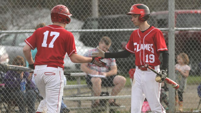 Mansfield Christian's Adam Stephen congratulates Connor Shard for scoring a run against Loudonville on Tuesday.