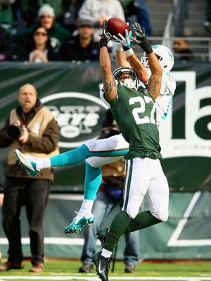 Jets cornerback Dee Milliner breaks up a pass to Dolphins wide receiver Brian Hartline during a game at MetLife Stadium on Dec. 1, 2013. The Jets are hoping to see more of these type of plays from Milliner, who has been either injured or ineffective for the majority of his career.