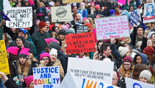 Demonstrators take part in the Women's March Sioux Falls event Saturday, Jan. 21, 2017, in downtown Sioux Falls. Thousands of people filled the streets of downtown Sioux Falls to show solidarity with women and South Dakotans, including members of the LGBTQ community.
