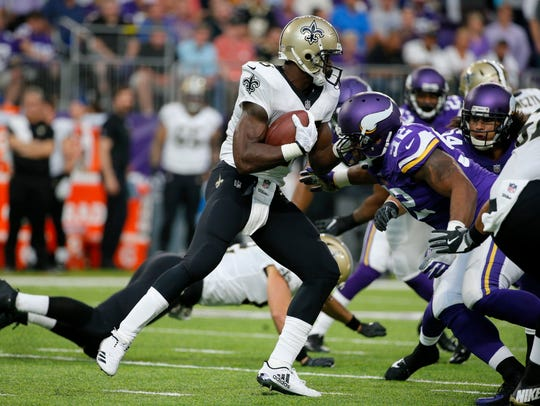 New Orleans Saints running back Adrian Peterson runs
