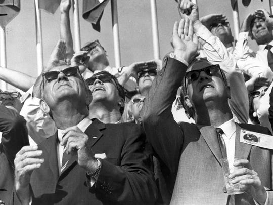 Amid a crowd of other onlookers, U.S. Vice President Spiro Agnew (right) and former U.S. President Lyndon B. Johnson watch the Saturn V vehicle roar skyward carrying the Apollo 11 manned spacecraft into the vast regions of space in this July 16, 1969 file photo. On a trajectory to the moon, the craft lifted off from launch pad 39 at Kennedy Space Center on July 16, 1969. The moon-bound crew included astronauts Neil Armstrong, commander; Michael Collins, command module pilot; and Buzz Aldrin, lunar module pilot. The mission finalized with splashdown on July 24, 1969. With the success of Apollo 11, the national objective to land men on the moon and return them safely to Earth had been accomplished. The Saturn V was developed by the Marshall Space Flight Center under the direction of Werher von Braun.