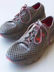 A pair of Under Armour SpeedForm Gemini 2 Record Equipped running shoes contain an embedded chip to track exercise.