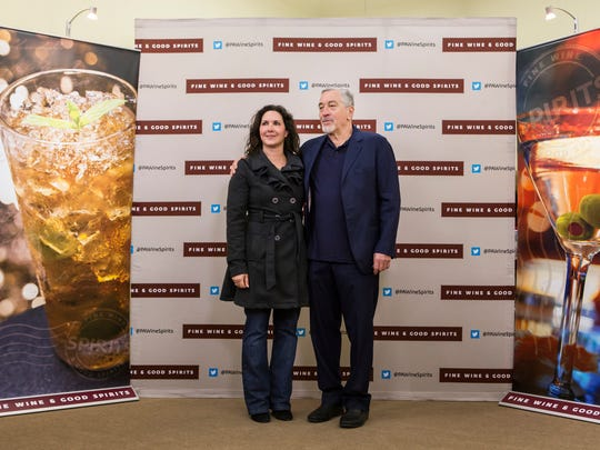 Oscar winning actor Robert De Niro poses for a picture with a fan at the grand opening of the Fine Wine & Good Spirits liquor store in Glen Mills, Pa. on Friday afternoon.