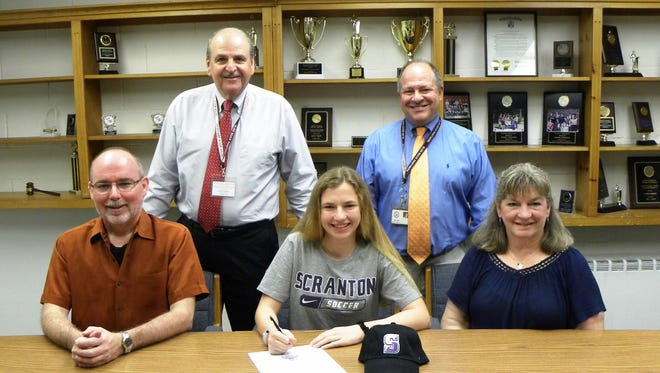 Glen Rock High School senior Mary Geen is joined by her parents Patrick and Leigh Ann as she signs to take her soccer talents to the University of Scranton next year. Also on hand for the celebration are (standing, from left) Glen Rock's Director of Athletics Frank Violante and GRHS Principal John Arlotta. Mary was a four-year varsity player for the Lady Panthers. In her senior year, she was appointed to first team all-league, second team all-county, and third team all-state.