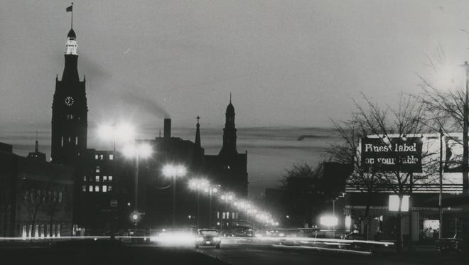 The clock on the Milwaukee City Hall tower is seen at dusk in this 1950 Milwaukee Journal photo. Daylight Saving Time ends Nov. 6.