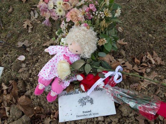 Baby Amelia Grace Hope's fresh gravesite is seen at