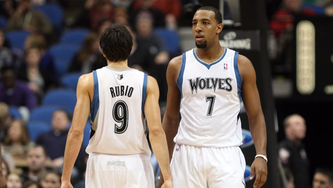 Minnesota Timberwolves guard Ricky Rubio (9) and forward Derrick Williams (7) during the first quarter against the Cleveland Cavaliers. Williams signed a two-year contract with the New York Knicks.
