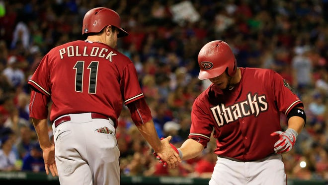 Arizona Diamondbacks catcher Welington Castillo (right) celebrates with center fielder A.J. Pollock (11) after hitting a two run home run during the fifth inning against the Texas Rangers at Globe Life Park in Arlington on July 8, 2015.