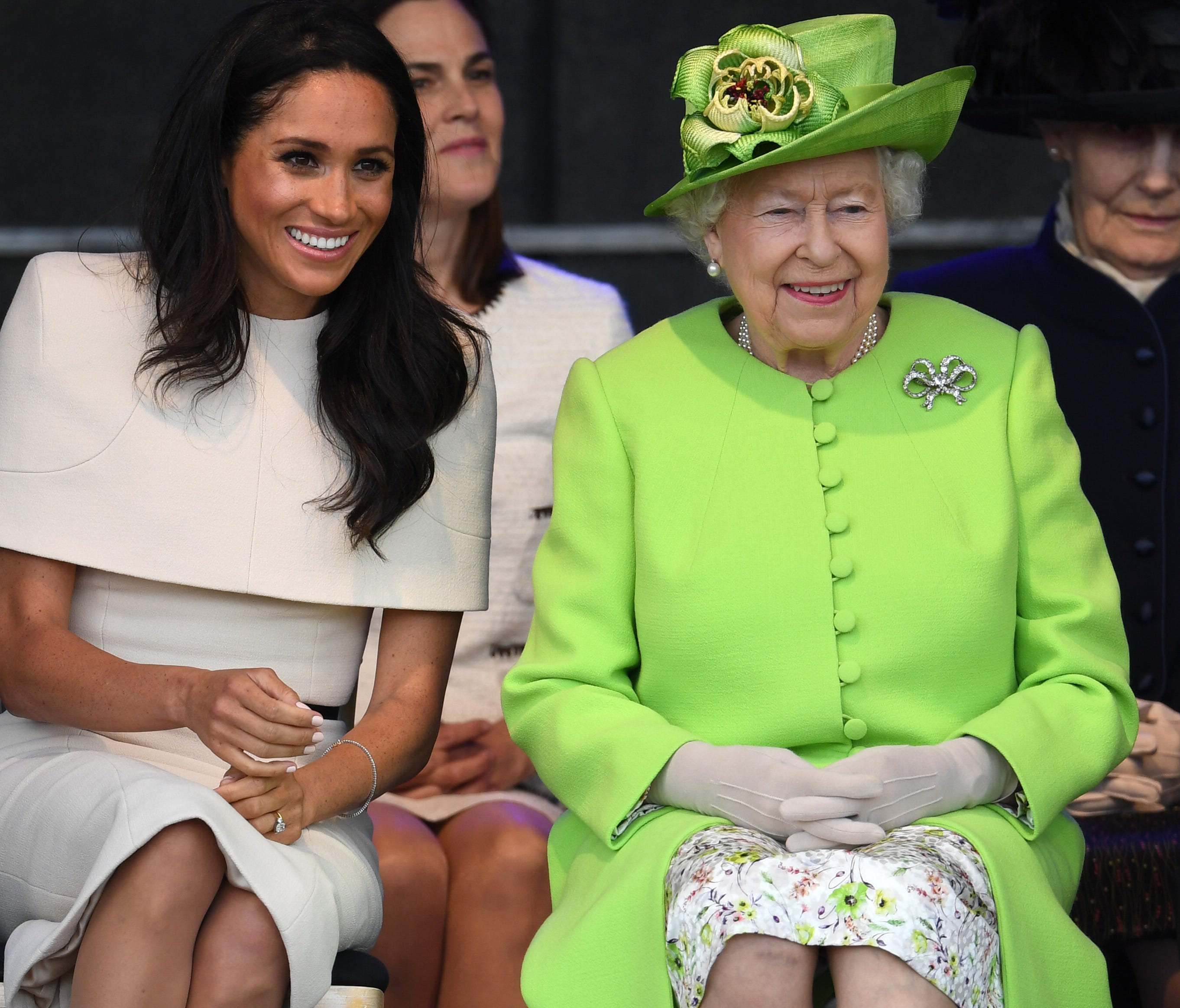 Queen Elizabeth II sits with Meghan, Duchess of Sussex during a ceremony to open the new Mersey Gateway Bridge on June 14, 2018 in the town of Widnes in Halton, Cheshire, England.