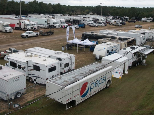 Race teams arrive in pit row Wednesday morning in preparation