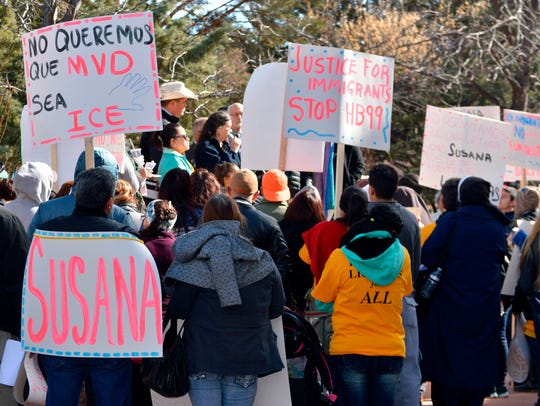 Immigrant advocates hold a rally Jan. 25, 2016 outside