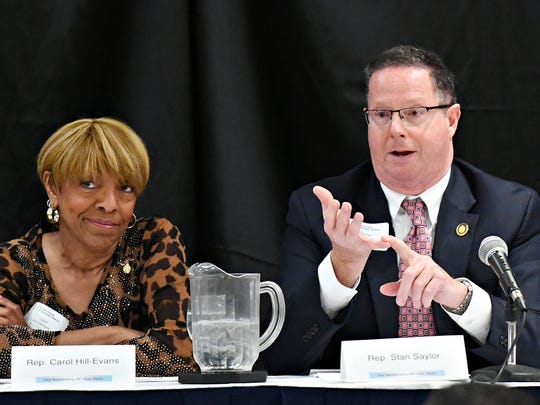 Rep. Carol Hill-Evans, of the 95th House District, left, reacts as Rep. Stan Saylor, of the 94th House District speaks during the Legislative Panel Discussion on the State Budget as the York County Economic Alliance hosts its Spring Legislative Luncheon at Wyndham Garden York in West Manchester Township, Thursday, May 17, 2018. Dawn J. Sagert photo