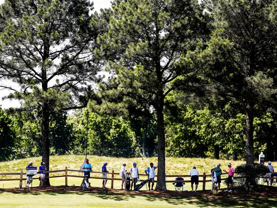 Fans find some shade on the 7th hole fairway during the InnerWorkings Pro-Am at the FedEx St. Jude Classic at TPC Southwind.