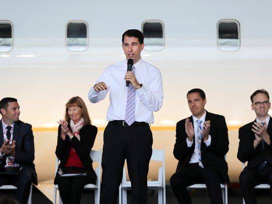 Gov. Scott Walker speaks after Air Wisconsin Airlines announced that the company will build a 30,000-square-foot maintenance facility this year at Appleton International Airport.