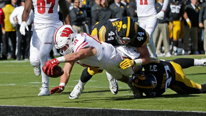 Wisconsin tight end Troy Fumagalli stretches to score a touchdown during the first half in the Badgers' 17-9 victory Saturday at Kinnick Stadium in Iowa City, Iowa.