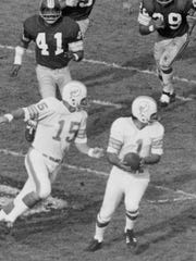 Miami Dolphins kicker Garo Yepremian held the ball Jan. 14, 1973, after it bounced into his hands after his kick was blocked by the Washington Redskins during the Super Bowl in Los Angeles. After Yepremian got the ball back, he tried to pass but it was deflected toward Washington Redskins' Mike Bass (41) who caught it and ran it in for a touchdown.
