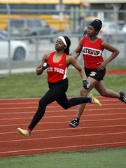 Janae Barksdale races Southfield-Lathrup's Autumn Hammond Wednesday. Barksdale is a fast freshman who should help the Knights remain a state power for years.