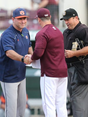 Auburn baseball coach Butch Thompson (left) shakes hands with Andy Cannizaro prior to Friday's game. Both coaches, along with Kentucky's Nick Mingione, are atop the SEC under John Cohen's coaching tree.