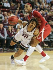 Mississippi State's Jazzmun Holmes (10) is fouled while