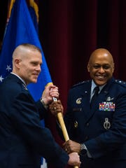 Lt. Gen. Anthony J. Cotton, right, is given command of Air University by Lt. Gen. Steven L. Kwast Commander of Air Education and Training Command, left, during an Assumption of Command Ceremony at Maxwell Air Force Base in Montgomery, Ala., on Wednesday February 14, 2018.