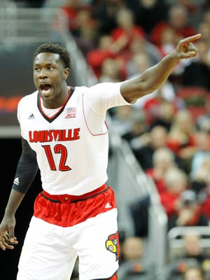 University of Louisville's Mangok Mathiang (12) reacts to his teammates against Jacksonville State during the first half of play at the KFC Yum! Center in Louisville, Kentucky.       November 17, 2014