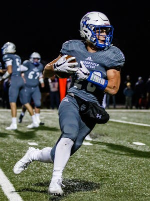 Brookfield Central running back Zach Heckman (28) races for the corner during the Level 4 Division 2 playoff game against Waukesha West at Oconomowoc on Friday, Nov. 10, 2017.