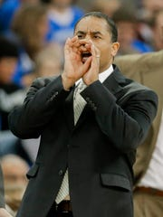 Loyola coach G.G. Smith yells instructions during the first half of an NCAA college basketball game against Creighton in Omaha, Neb., Saturday, Nov. 26, 2016. (AP Photo/Nati Harnik)