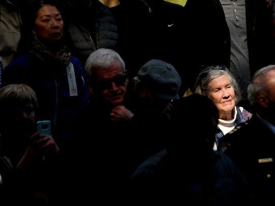 Bainbridge resident Holly Wilson is illuminated by a ray of sunshine as she and fellow attendees listen to the presenters Thursday during the 75th anniversary commemoration ceremony at the Bainbridge Island Japanese American Exclusion Memorial.