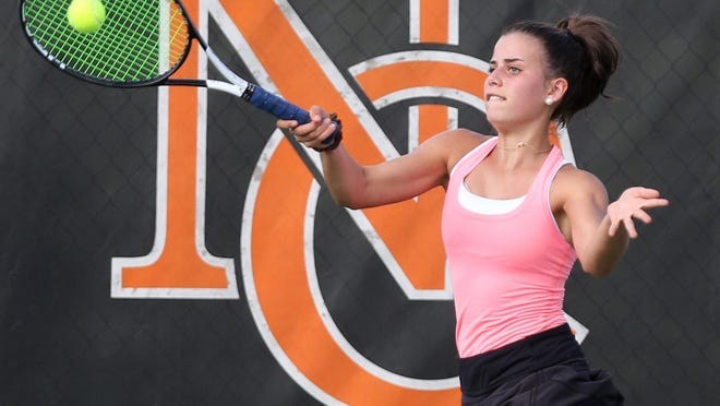 Hoover's Lilly Altman returns a shot against Jackson's Paige Reese during their number 2 match at Hoover on Monday, Sept. 16, 2019.