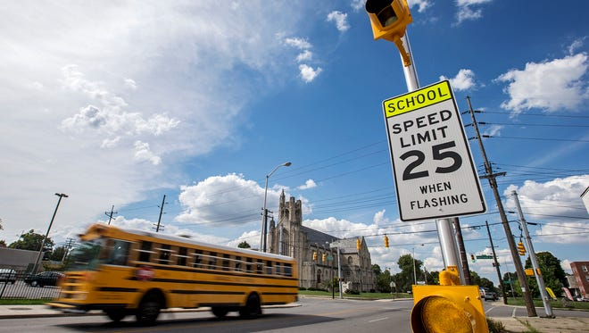 A new school zone sign at 34th Street and Central Avenue, near Indianapolis Public School 48, seen Monday, Aug. 8, 2016. The new signs have lights that flash during arrival and dismissal, requiring drivers to slow down only during those windows of time.
