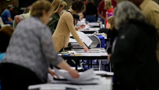 Votes being recounted at the Macomb Community College Sports and Expo Center in Warren, MI on Tuesday, December 6, 2016.