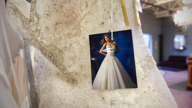 A photo attached to a wedding dress shows how it is designed to look Wednesday, Jan. 4, at Carrie Johnson Bridal in Waite Park.