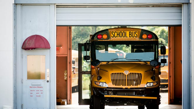 Muncie Community School buses are parked at the Auxilio Services lot on Martin Luther King Jr. Blvd. Thursday morning. After transportation issues created problems on the first day of school, school was cancelled Thursday.