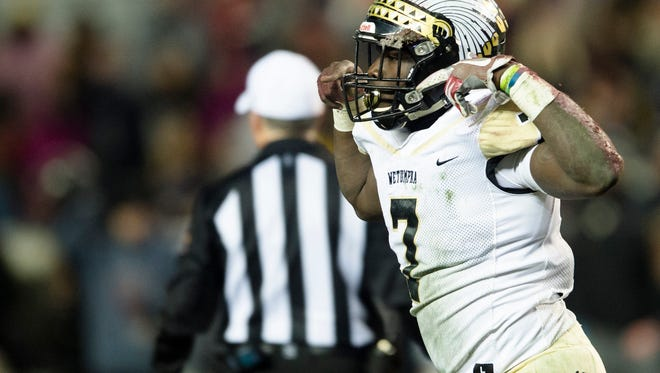 Wetumpka's Kavosiey Smoke celebrates after scoring a touchdown during the AHSAA Class 6A Football State Championship on Friday, Dec. 8, 2017, in Tuscaloosa, Ala.