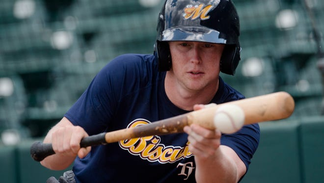 Biscuits short stop Jake Cronenworth bunts during the Biscuits opening practice on Tuesday, April 3, 2018, in Montgomery, Ala.