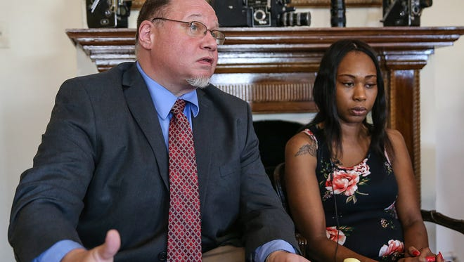 From left, attorney Craig Karpe and Erica Bailey, daughter of Aaron Bailey, speak with media at the office of Karpe Litigation Group in Indianapolis, Wednesday, May 23, 2018.