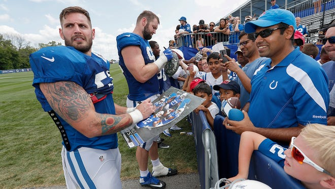 Indianapolis Colts linebacker John Simon (51) and Margus Hunt (92) sign autographs for fans following the Colts third day of training camp at Grand Park in Westfield on Saturday, July 28, 2018.