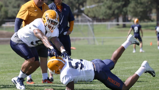 UTEP transfer linebacker A.J. Hotchkins works on a drill against teammate Barron Wortham Jr. during Camp Ruidoso Monday.