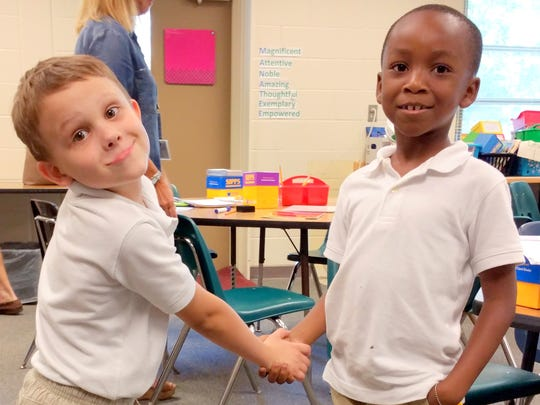 Two young program members show their enthusiasm during a break at Manatee Elementary School.