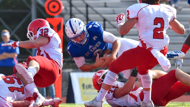 St. Xavier's Chase Wolf rushes for a touchdown late in the first half against Hinsdale Central Saturday, August 26th at Princeton High School