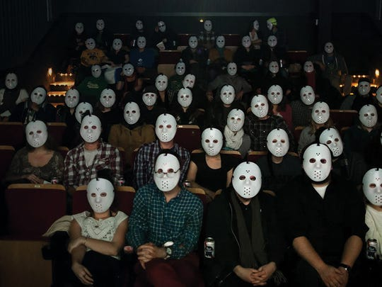 "An audience at FilmScene watches ""Friday the 13th."""