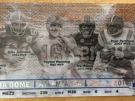 The tickets for the 2016 SEC championship game features images of past MVPs, including Barron Collier graduate Terry Dean (far right). Dean was MVP of the 1993 SEC championship as quarterback for the Florida Gators.