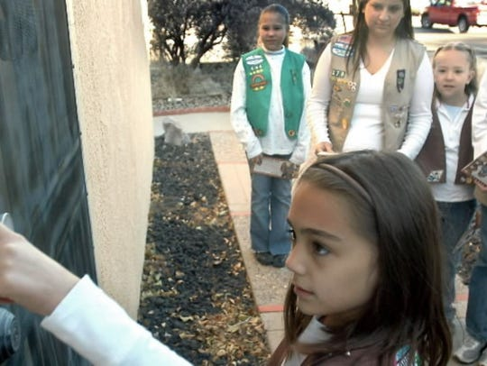 Girl Scouts selling cookies in New Mexico.