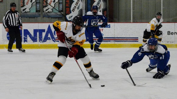 Pearl River's Matthew Lotto dives to block a shot by