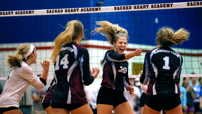 Assumption's Kayla Kaiser celebrates with her teammates after scoring against Sacred Heart. From left to right are Payton Frederick, Anna DeBeer, Kaiser and Camille Nazor. Aug. 30, 2017