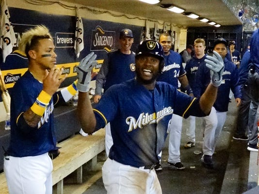 636597776329031359-AP-MARLINS-BREWERS-BASEBALL-68320770.JPG